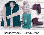 knitwear on a wooden background.... | Shutterstock . vector #319320965