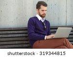 handsome man on the street | Shutterstock . vector #319344815