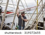 deckhand working on the deck of ... | Shutterstock . vector #319372655