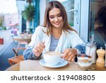 young woman in a cafe | Shutterstock . vector #319408805