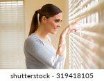 beautiful woman peeking through ... | Shutterstock . vector #319418105