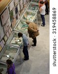 """Small photo of ST. PETERSBURG, RUSSIA - SEPTEMBER 18, 2015: People in the exhibition """"Book And Manuscript Collection Of Academician N. P. Likhachev"""". The exhibition opened in the National Library of Russia"""