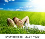 young man in spring grass | Shutterstock . vector #31947439