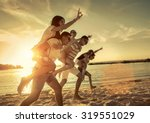 friends fun on the beach under... | Shutterstock . vector #319551029