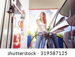 pretty young woman refuel the... | Shutterstock . vector #319587125