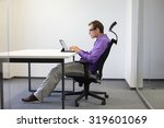 Small photo of text neck - man in slouching position on ergonomic chair working with tablet at desk