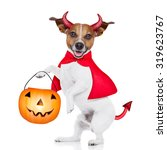 halloween devil pug dog with... | Shutterstock . vector #319623767