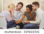colleagues supporting tensed... | Shutterstock . vector #319631531