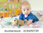 baby boy playing with soft toy...   Shutterstock . vector #319690739