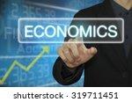 business man pointing economics. | Shutterstock . vector #319711451