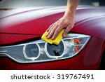 male hand wiping car headlights | Shutterstock . vector #319767491