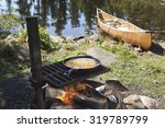 fish cooking in a frying pan... | Shutterstock . vector #319789799