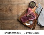 thick raw t bone steak with...   Shutterstock . vector #319810301