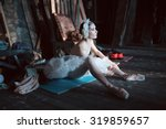 Prima Ballerina Sitting On The...