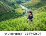 girl in the terrace rice farm... | Shutterstock . vector #319942607