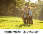 grandfather and grandson... | Shutterstock . vector #319959089