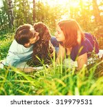 beautiful couple with dog... | Shutterstock . vector #319979531