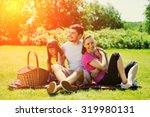family on picnic at sunny day   Shutterstock . vector #319980131