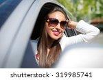 pretty girl in a car | Shutterstock . vector #319985741