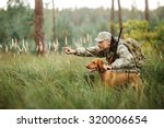 Hunter With Rifle And Dog In...