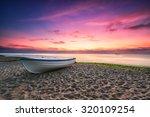 Boat And Violet Sunrise