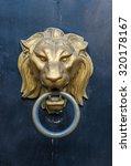 Lion Head Doorknocker On A...