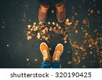 couple man and woman feet in... | Shutterstock . vector #320190425