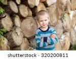 Little Blond Boy In A Striped...