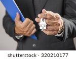 real estate agent handing over... | Shutterstock . vector #320210177