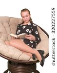 Small photo of Girl teenager reading dook