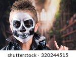 Scary Little Boy Wearing Skull...