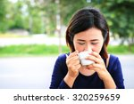 smile asian woman holding cup... | Shutterstock . vector #320259659