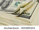 cash dollars lying on the plane. | Shutterstock . vector #320385341