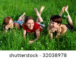 three young laughing girls lay... | Shutterstock . vector #32038978