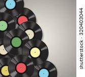 black vinyl records isolated on ... | Shutterstock .eps vector #320403044