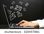 email concept with laptop and... | Shutterstock . vector #320457881