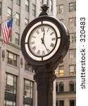 This is a shot of a classic style clock on Fifth Ave. in Manhattan. - stock photo