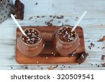chocolate and banana smoothie... | Shutterstock . vector #320509541