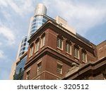 This photo shows the mixture of old and modern styles of architecture in Manhattan. - stock photo