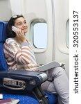 caucasian woman passenger in... | Shutterstock . vector #320553137