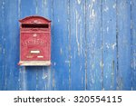 Red Mailbox With Blue Wood...