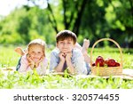 sister and brother in the park... | Shutterstock . vector #320574455