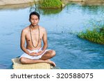 a young brahmin sits in... | Shutterstock . vector #320588075