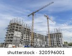 hoisting crane and new multi... | Shutterstock . vector #320596001