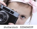portrait of a girl with camera... | Shutterstock . vector #320606039
