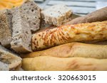 variety of breads on wooden... | Shutterstock . vector #320663015