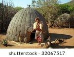 Small photo of MANTENGA, SWAZILAND - JULY 15 : Sangoma, the local magician after a healing ceremony 15. July 2000. Mantenga Nature Reserve