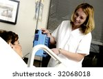 Nurse with patient - stock photo