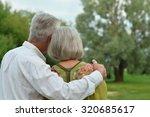 loving mature couple on a walk... | Shutterstock . vector #320685617