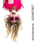 a little girl with upside down... | Shutterstock . vector #320687807